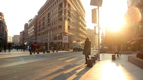 Slow Motion. Pedestrians walking on the background golden sunset in the city.  stock footage