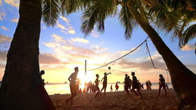 Slow motion. People playing volleyball at tropical beach.Boracay island, Philippines summer vacation stock footage