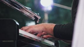 Piano playing. Close-up. Musical theme. Concert program. Slow motion. Piano playing. Close-up. Musical theme Concert program stock video
