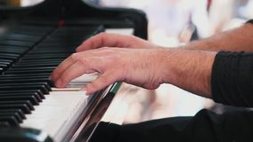 Piano playing. Close-up. Musical theme. Concert program. Slow motion. Piano playing. Close-up. Musical theme Concert program stock footage