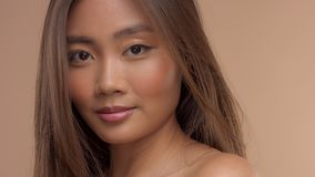 Thai asian model with natural makeup on beige background stock video