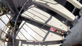 Slow motion POV video of young man walking up the stairs on water slide at aquapark