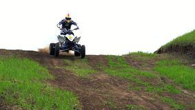 Slow motion: racer male moves on the ATV on an extreme route. Racer quickly overcomes the turns and makes jumps on the. Hills. Spring cloudy day stock video