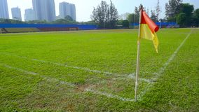 Slow motion of red and yellow corner flag stock video