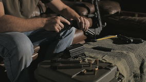 Slow Motion Removing Magazine and Cleaning .45 Caliber Semi-Automatic Gun