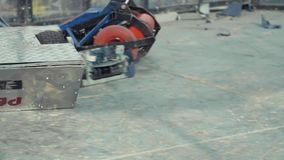 Slow motion robots battling on arena at competition. Slow motion scrathed metal radio controlled battling on pile wood surface arena at competition stock video