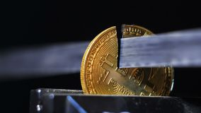 Slow Motion Saw Cuts Off Golden Coin Created As Cryptocurrency stock video footage