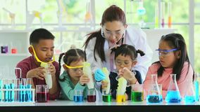 Science teacher and students, they do experiment. stock video footage