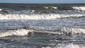 Slow motion sea waves go to the shore. Slow motion sea waves go to the shore stock footage