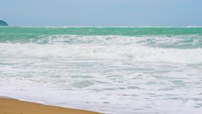 Slow motion, sea waves on a tropical island with a sandy beach, a paradise for tourists.  stock footage