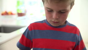 Slow Motion Sequence Of Boy Recycling Kitchen Waste In Bin stock footage