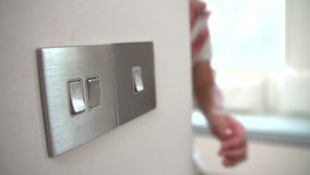 Slow Motion Sequence Of Boy Turning Off Light Switch stock footage