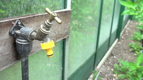 Slow Motion Sequence Of Dripping Tap In Garden Stock Image