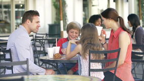 Slow Motion Sequence Of Family Enjoying Snack At Caf� stock footage