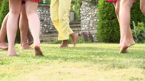 Slow Motion Sequence Of Feet Having Fun In Garden Royalty Free Stock Photography