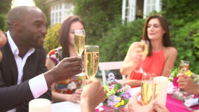 Slow Motion Sequence Of Friends Proposing Champagne Toast Stock Photos