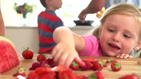 Slow Motion Sequence Of Girl Eating Strawberry Royalty Free Stock Photography