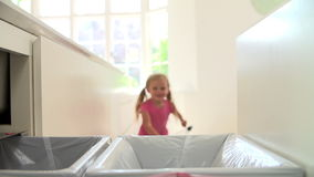 Slow Motion Sequence Of Girl Recycling Kitchen Waste In Bin stock video footage