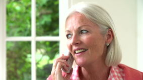 Slow Motion Sequence Of Middle Aged Woman On Phone stock video footage