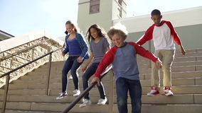 Slow Motion Sequence Of Teenagers Running Down Stairs stock video footage