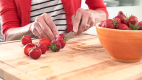 Slow Motion Sequence Of Woman Cutting And Eating  Strawberry Stock Photo