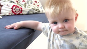Slow Motion Sequence Of Young Boy Learning To Walk stock video footage