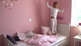Slow Motion Sequence Of Young Girl Jumping On Her Bed Royalty Free Stock Photo