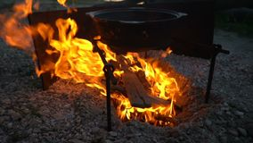 shooting of cauldron on a fireplace stock video footage