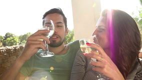 Slow Motion Shot Of Couple Drinking Wine Together. Slow motion sequence of couple drinking wine outdoors together and making a toast.Shot on Sony FS700 at frame stock footage