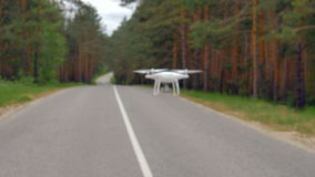 Slow motion shot drone flying along road.