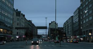 Evening traffic, cars and lights in the city of Stockholm, slow motion stock video footage