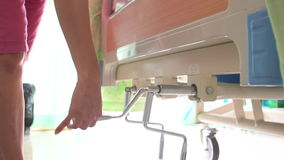 Slow motion shot of Female hand Lying in Hospital on manual Bed stock footage