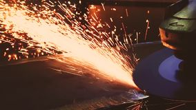 Slow motion shot of metal cutting by abrasive disc. Lots of flying sparks.  stock video