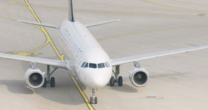 Slow motion shot of passenger airplane taxiing at the airport. Passenger airplane taxiing at the airport stock footage