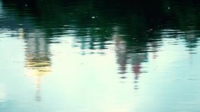 River ripple reflecting catholic orthodox cathedral in Moscow region. Slow motion shot of river ripple reflecting catholic orthodox church stock footage