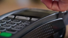 Slow motion shot of swiping pos card-reader stock video footage