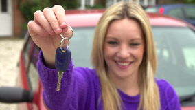 Slow Motion Shot Of Teenage Girl Standing By Car With Key Royalty Free Stock Images
