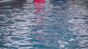 Slow motion shot of water ripple in indoor swimming pool before water polo game stock video footage