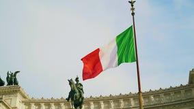 Slow motion shot of waving flag of Italy on Vittorio Emanuele palace background. Slow motion shot of waving flag of Italy on blue sky background. Rome, Vittorio stock footage