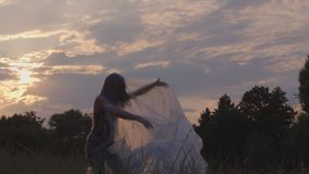 Dancing In Plastic At Sunset In Nature