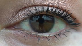 Slow-motion single eye close up stock video footage