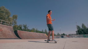 Slow motion Skateboarder doing tricks in a city. Steadicam shoot. stock video footage