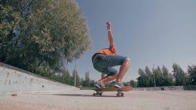 Slow motion Skateboarder doing tricks in a city. Steadicam shoot. Skateboarder doing tricks in a city. HD stock footage