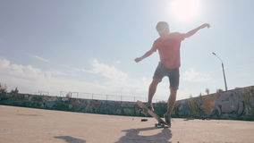 Slow motion Skateboarder doing tricks in a city. Steadicam shoot. stock video