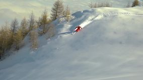 Slow motion skier carving through thick fresh powder snow. Skier on the mountain. Fresh powder snow. winter sport. Ski carving in stock footage