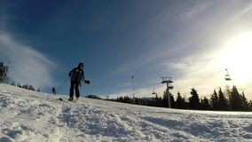 Slow motion of a skier skiing down the slope. In a beautiful sunny day stock footage
