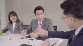 Slow motion - Smart business man and beautiful woman secretary present project by tablet to his boss to approve and shaking hands.