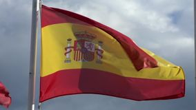 Slow motion of spanish flag waving in the wind on flagpole at an city. Spain stock video