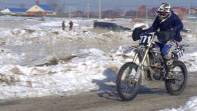 Slow motion: sportsman racer man fulfills a fast ride on a motorcycle on the road extreme. The race track is very curve stock video footage