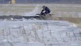 Slow motion: sportsman racer man fulfills a fast ride on a motorcycle on the road extreme. The race track is very curve stock video